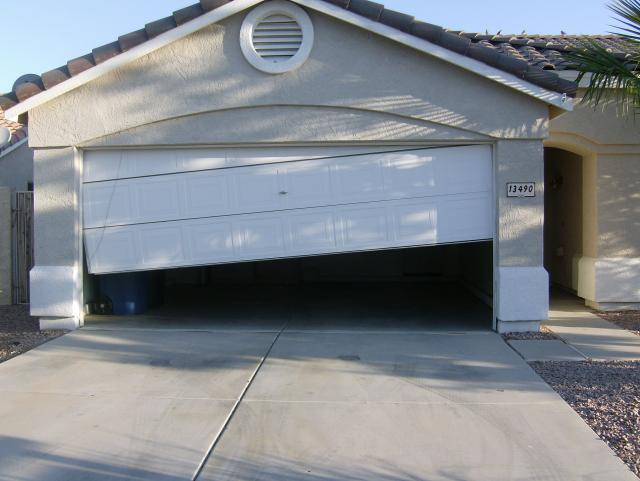 fix off track garage doors orlando - Garage Door Off Track