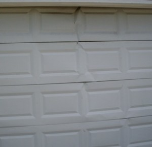 cracked-garage-door-panels-Orlando