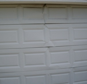 Cracked Panel Maintenance And Replacement. Cracked Garage Door Panels  Orlando